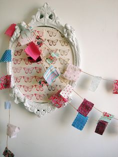 Now, this is the kind of bunting I like! Not too cute, not over-structured, with more than a hint of genuine scrap.