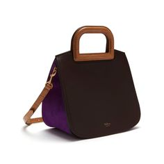 Shop the Brimley in Gold Ochre, Chocolate & Dark Violet Leather at Mulberry.com. The new Brimley celebrates the endless potential of beautiful leather, combining a classic satchel style with minimalist detailing and a nod to traditional craftsmanship with its visible stitching. The new collection includes striking colour and texture combinations including jewelled signatures and multi-leather textures.