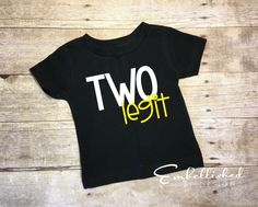 """Does your little one have a 2nd birthday coming up? Check out our """"Two Legit"""" birthday shirt! This design is heat pressed on a Rabbit Skins top with high-quality commercial heat transfer vinyl."""