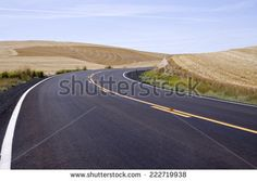 Newly paved rural highway curves to the right, Palouse Valley, eastern Washington State, USA - stock photo