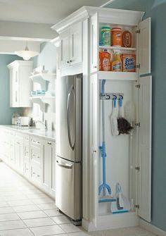 Add a cabinet to any dead space in your kitchen or laundry room for cleaning supplies. | 33 Insanely Clever Upgrades To Make To Your Home #smallkitchendesign #diysmallkitchen