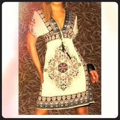 Fall SALE-Bohemian Chic Dress - New! Must Have! All 5 star rated! Have more sizes available now due to popularity! You have to have this wardrobe staple! Bohemian chic dress. New without tags. The perfect dress! Knee length with plunging neckline. So soft! Dresses Midi
