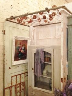 Junk Chic Cottage chain link gate with grapevine balls on old doors