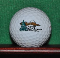 Alpine Golf Course at Aviano Air Force Base in Italy logo golf ball.
