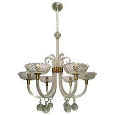Elegant Seguso Murano Glass Chandelier | From a unique collection of antique and modern chandeliers and pendants at https://www.1stdibs.com/furniture/lighting/chandeliers-pendant-lights/