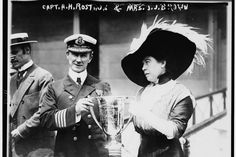 """Mrs. J.J. Brown (""""The Unsinkable Molly Brown"""") presenting a trophy cup award to Carpathia Captain Arthur Henry Roston for his service in the rescue of the Titanic. Library of Congress"""