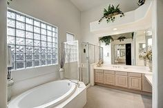 The Pretty Master Bathroom Has Double Sinks A Walk In Glass Surround Shower And