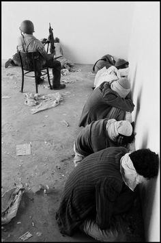 ISRAEL. 1956. Palestinian prisoners being guarded by Israeli soldiers during the Sinai campaign. Burt Glinn.