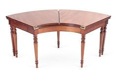 Curved table with fold-over sides and turned swing legs, England, circa 1960.