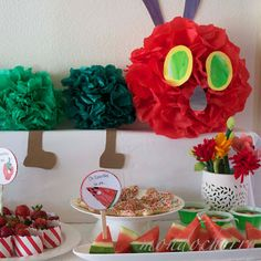 hungry caterpillar party...Caterpillar decoration created from tissue paper pom poms in different shades of green and red