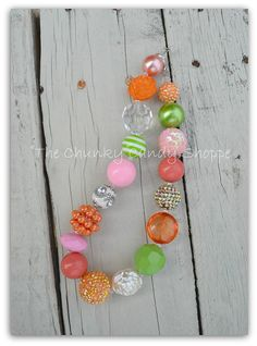 "Girls m2m Matilda Jane's, ""Sundew"" and ""Faircloth""...orange, pink, coral, lime unpredictable chunky necklace. $25.00, via Etsy."