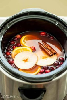 Slow Cooker Cranberry Apple Cider Recipe The Recipe Rebel - The perfect holiday drink, this Slow Cooker Cranberry Apple Cider is made with apple, cranberry and orange juices! Perfect for your Thanksgiving or Christmas party. Thanksgiving Cocktails, Thanksgiving Recipes, Fall Recipes, Holiday Recipes, Thanksgiving Birthday, Christmas Recipes, Slow Cooking, Cooking Recipes, Easy Cooking