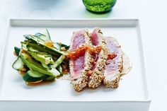 Sesame-crusted tuna with chilli & ginger dressing - A member of the mackerel family, tuna is a magnificent fish. Get the lowdown on this versatile ingredient and sample this great dish. Tuna Recipes, Seafood Recipes, Asian Recipes, Cooking Recipes, French Recipes, Sesame Crusted Tuna, Fisher, Seared Tuna, Dressing Recipe