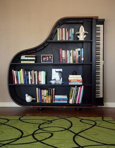 22 Creative Bookshelves Guaranteed to Give You Shelf Envy This creative bookshelf, shaped like a piano, would be a great addition to any home library.