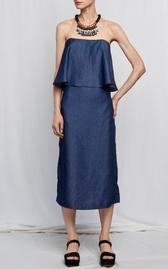 This **Whit** dress is rendered in an eco chambray and features a square strapless neckline, loose bodice panel, and a midi length column silhouette.