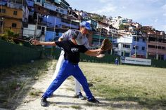 "A pitcher practices during a baseball practice at the ""Mamera"" neighborhood in Caracas March 10, 2011.  REUTERS/Jorge Silva"