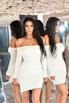 Wow:The entrepreneur looked absolutely beautiful in a curve hugging white dress, which showed off her incredible form
