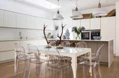 Kitchen with Kartell Louis Ghost chairs around the dining table