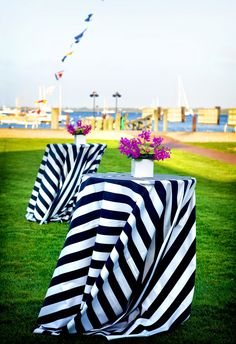 love the navy striped tablecloths, especially for outside at the cocktail hour at yacht club -- fun, nautical vibe!