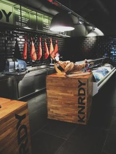 Industrial chic steakhouse in Budapest with stainless steel, butcher block, and black subway tile. | japanesetrash.com