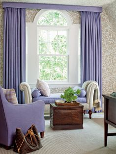 Proof purple can be used in home decor and look sophisticated and beautiful! Purple chaise and lounge chairs, with purple drapes.