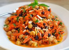 Moroccan Carrot & Chickpea Salad- TESTED & PERFECTED RECIPE- With fragrant spices, bright colors & savory flavors, this exotic twist on the carrot-raisin salad is a feast for the senses. Moroccan Carrots, Moroccan Chicken, Moroccan Salad, Moroccan Chickpea Salad, Moroccan Style, Carrot Salad Recipes, Cooking Recipes, Healthy Recipes, Delicious Recipes