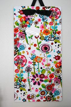 "Fabric covered magnet board. I just bought an ""as-is"" magnet board at IKEA for $2.99 WITH 4 magnets (unfortunately RED, but that will be changed QUICKLY). I am going to cover it with an awesome print... I just have to decide which one! The only thing I found wrong with it is there is no hardware included to hang it... I have that available at home already!"