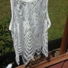 SEXY LACE TOP~WHITE WHITE LACE TOP VERY SEXY PAIR WITH YOUR SKINNY JEANS AND CUTE BRALETTE great for summer and night out  Sleeveless tank top with lace detailed No tag saying size but fits size XS /S NWOT MiraBelle boutique Tops Tank Tops