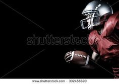 Side view of aggressive sportsman playing American football against black American Football, Football Helmets, Poses, Side View, Black, Figure Poses, Black People, All Black, Football
