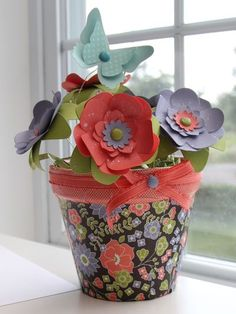 Make these paper flowers to stick in candy bouquet gifts. 1 or 2 of them should work just fine! The clay pot's an awesome idea too! (Stampin' Up Berry Blossoms Designer Paper by Heather)