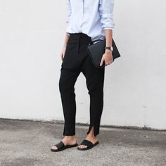 Le Fashion Blog Masculine Inspired Minimal Style Light Blue Button Down Shirt Black Drop Crotch Pants Ankle Slit Common Projects Black Slide Sandals Via Modern Legacy photo Le-Fashion-Blog-Masculine-Inspired-Minimal-Style-Button-Down-Shirt-Drop-Crotch-Pants-Slide-Sandals-Via-Modern-Legacy.jpg