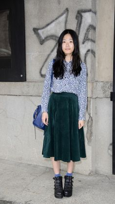 This blue patterned blouse looks great tucked into a velvet green skirt and teamed with street style black wedge boots. Playful AND professional. See more at www.redonline.co.uk.