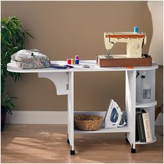 The Wildon Home Duncan Laminate Sewing Table snugly fits your sewing machine making it comfortable to use. This sewing table is made of wood and manufactured wood, which ensures that it is sturdy and Sewing Station, Craft Station, Storage Shelves, Storage Spaces, Shelf, Easy Storage, Ikea Storage, Cabinet Storage, Craft Storage