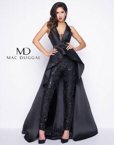 Sleeveless, tuxedo collar, high low skirt with detached, satin and lace applique, skinny pants with ankle zipper. Available in Black and Ivory/Nude.