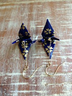 Origami crane earrings in blue and gold with by ThePaperFuchsia