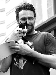 James Franco with kitten. Cuddles! You can see the love in his face.  This is totally going to be Logan when he grows up