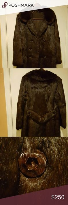 """Vintage fur coat Custom made for my grandmother years ago so there are no labels. Feels luxurious to the touch.  I can give measurements since it's not sized. She was a petite woman so it's cut small.  Length from top to bottom 34"""", width all the way around between the 1st and 2nd button is 37 1/4"""", width all the way around under the arms is 36 1/4"""", sleeves from underarm are 15"""", top of the sleeves are 22"""" and shoulders are 17"""". Buttons and hooks are in perfect condition. Jackets & Coats"""