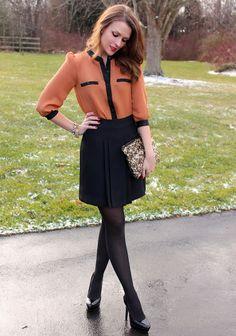 rust blouse, black skirt, black tights, black heels