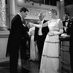 Scene from Anastasia.  Ingrid introduced by Yul Brynner at a Ball.