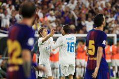 Mateo Kovacic #16 of Real Madrid celebrates with teammates after scoring a goal in the first half against the Barcelona during their International Champions Cup 2017 match at Hard Rock Stadium on July 29, 2017 in Miami Gardens, Florida.