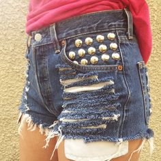 """3X HP  Studded Levi Cut-off Shorts HP  7/22 Fresh Fashion Party  8/16/15 Casual Cool Party  8/18/15 Get It Girl Party  Vintage high-waisted dark blue denim Levi's 501s. Silver studded front pocket. Frayed cut off hems with exposed pockets hanging out. Perfect for a summer festival look! Bought used but rarely worn personally. Like new! Size on tag is 29 but fits smaller. Measurements taken across the front lying flat: waist 13.5"""" - hips 18.25"""" - rise 10.75"""" - inseam 2.5"""" Levi's Jeans"""