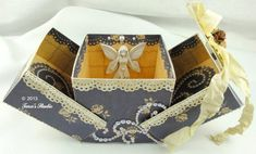 Elegant gift box with main body made from one piece of cardstock. Tutorial