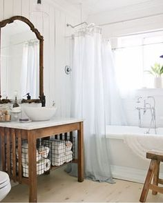 Did you see this gorgeous master bath makeover by @camitidbits? Whites and wood tones... ❤️ Her feed is so bright and airy. Definitely #onetofollow Happy Friday!