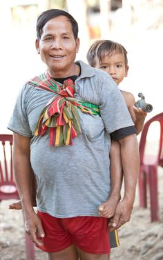 Man and boy, Som village, Cambodia  (photo by Anna Willett). Construction was completed this summer and UWS Som School is set to officially open for lessons in October 2014.