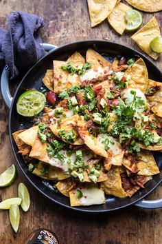 Chipotle Braised Chicken Nachos recipe: Slow cooked chicken, braised in cider be… Slow Cooked Chicken, Braised Chicken, How To Cook Chicken, Shredded Chicken, Chicken Nachos, Chipotle Chicken, Good Food, Yummy Food, Cooking Recipes