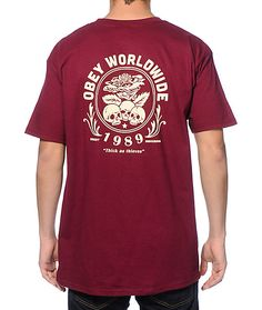 Brighten your street outfits with a burgundy colorway that showcases an Obey Worldwide 1989 floral rose skulls graphic on the left chest and back.