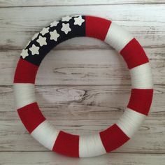 This wreath was created by wrapping red, white, and blue yarn around a 14 inch wreath form. A larger section of blue was created with 13 red and white stripes. I then hand painted stars white. There are 13 wooden stars on this wreath to represent the original 13 colonies. This would be a great addition to your patriotic home decor or for your 4th of July celebrations!  Please use the drop down menu to let me know if you would like twine attached to the back of the wreath for hanging…