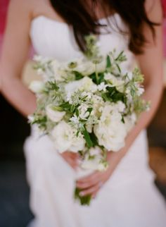 The bridesmaids will carry bouquets of white flowers paired with silver brunia, white astilbe, blue tweedia, silver sage, seeded eucalyptus, and rosemary wrapped in ivory linen.  The white floral element will either be ivory lisianthus, white scabiosa, or ivory spray roses.