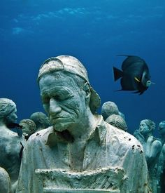 Underwater sculpture by Jason De Caires. Placed in tropical waters, over time these concrete sculptures will be colonised by corals, adding to the reef system.