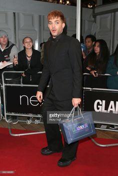 Adam Lambert and his goodie bag at GlamourUK Awards